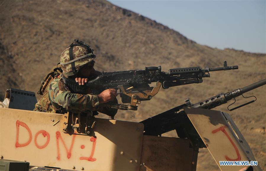 Afghan security force members take part in military operation