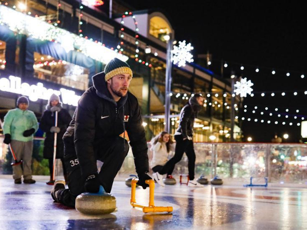 People participate in curling lessons in Chicago, U.S.