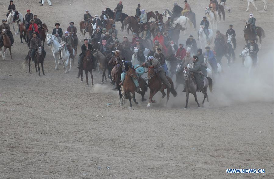 Afghan horse riders compete for goat during Buzkashi match in Dushi district of Baghlan province