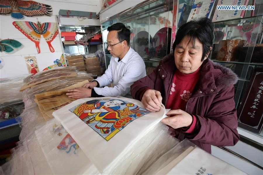Workers make wood-block paintings in China's Shandong to supply festival market