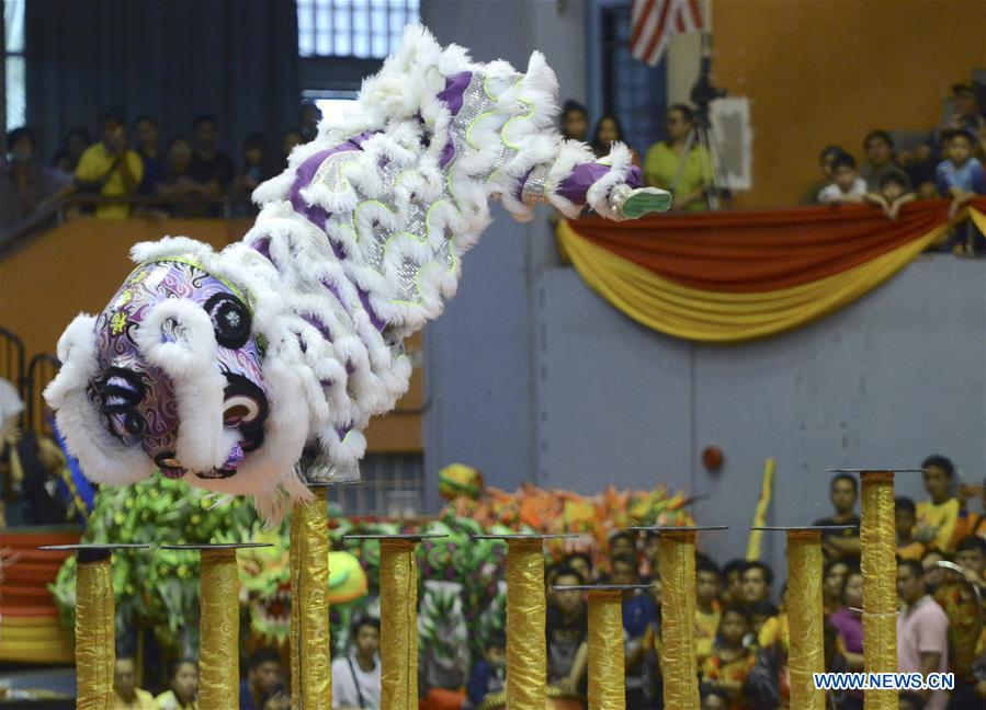 Folk artists perform lion dance to greet upcoming Chinese New Year in Malaysia