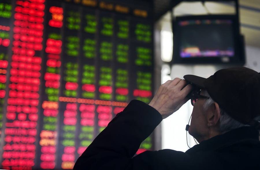 Chinese shares higher at midday Monday