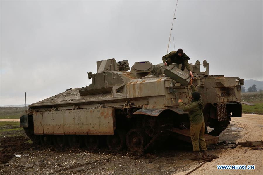 Israeli troops attend drill in Golan Heights