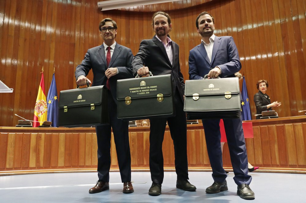 Despite differences, Spain gets its new coalition government