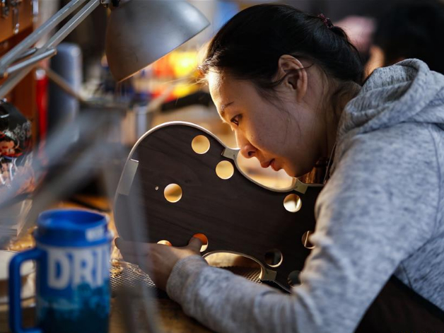Students make violins at Chicago School of Violin Making in Skokie, US