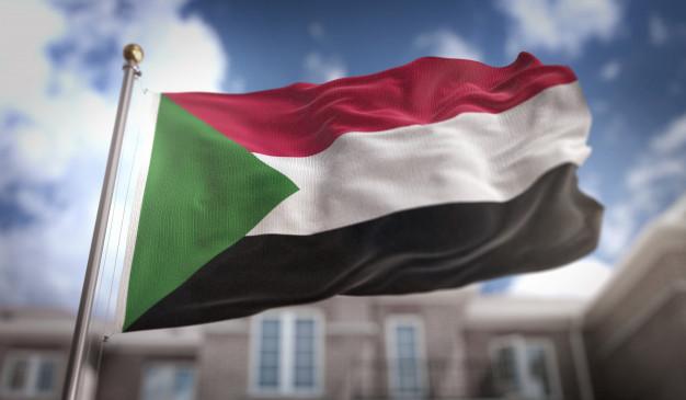 sudan-flag-3d-rendering-blue-sky-building-background_1379-1449.jpg