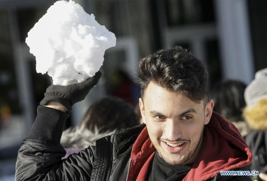 Students take part in snowball fight at University of British Columbia
