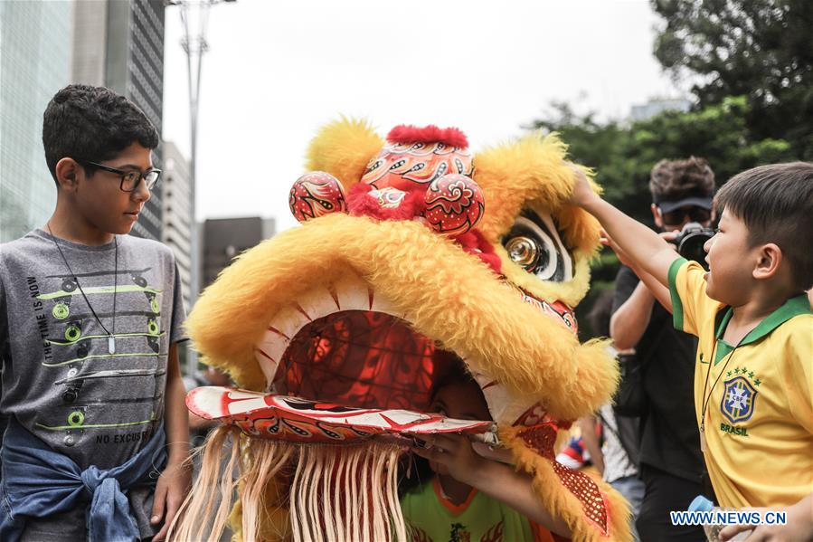 People view flash mob celebrating upcoming Chinese Lunar New Year in Sao Paulo