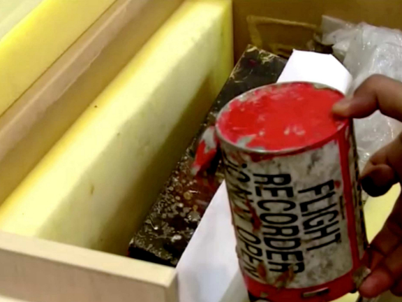 Iran to examine downed plane's black boxes, no plan yet to send them abroad