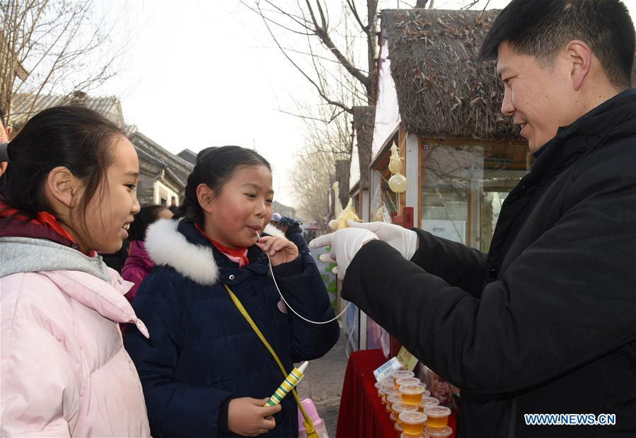 Spring Festival market themed on intangible cultural heritages