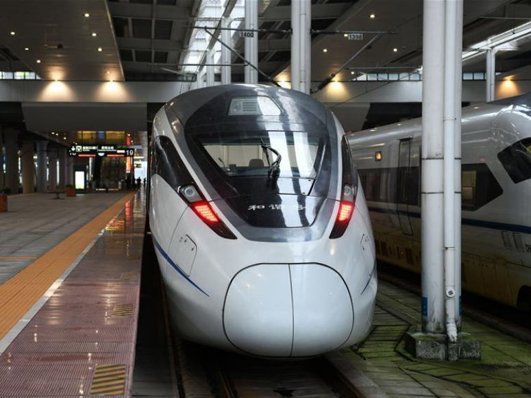 China's expanding high-speed railway makes journeys home easier, cozier