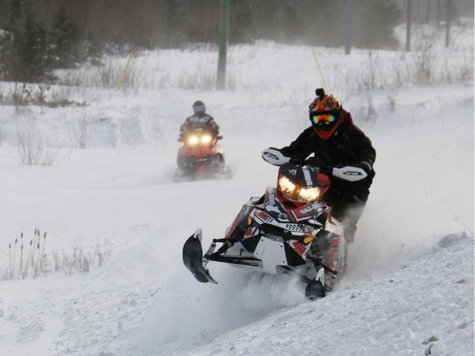 One dead, five missing as snowmobile falls through ice in Canada