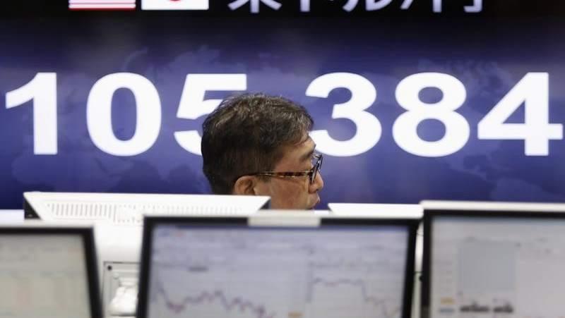 Tokyo stocks lose ground in morning on profit-taking, yen's rise