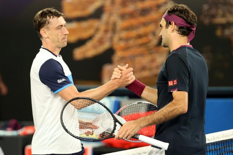 Federer survives five-set epic at Australian Open