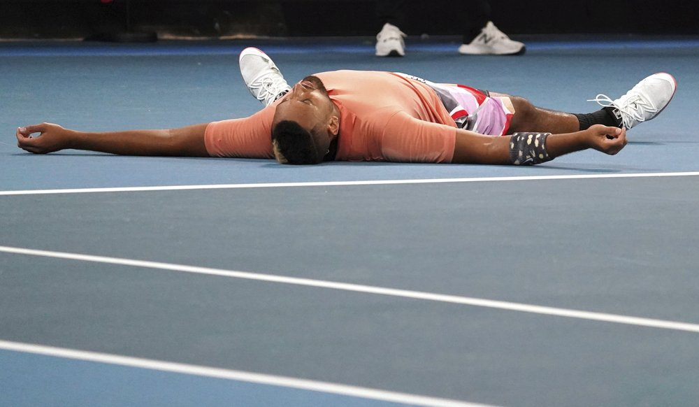 Bloodied but unbowed, Kyrgios sets Nadal clash in Australia