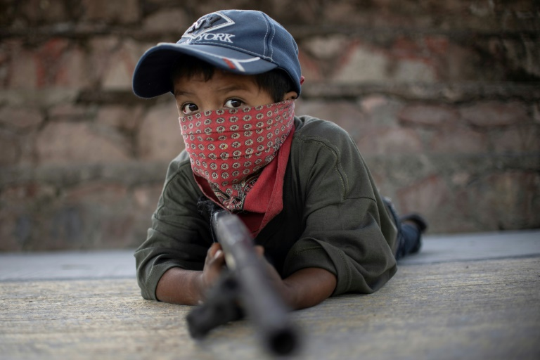 Mexican children take up arms in fight against drug gangs