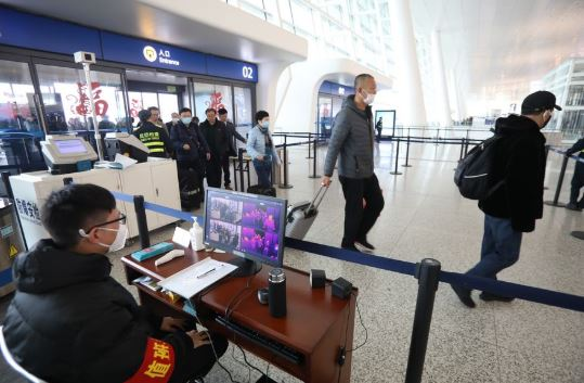 China tightens measures to curb cross-border spread of new coronavirus