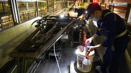 Railway staff stick to post to ensure safety of Spring Festival travel rush