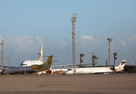 Tripoli airport hit by rocket fire as UN slams Libya arms violations