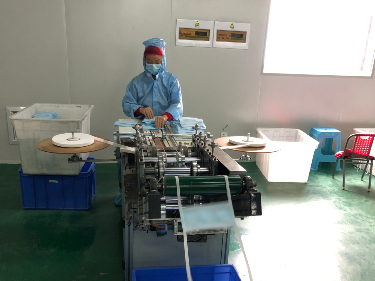 Wuhan manufacturers work overtime to ensure supplies of masks and protective suits