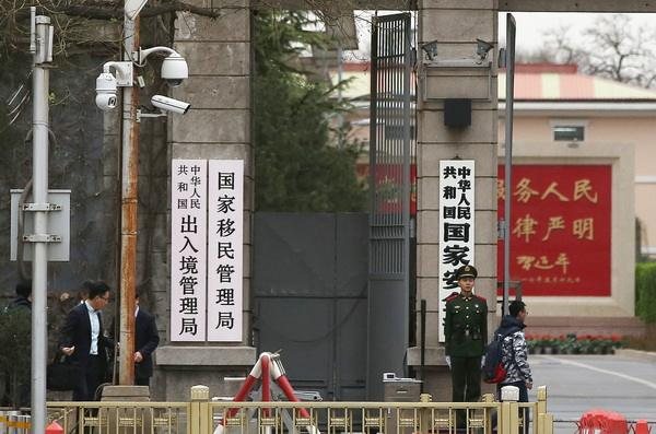 China advises citizens postpone overseas travel amid virus outbreak