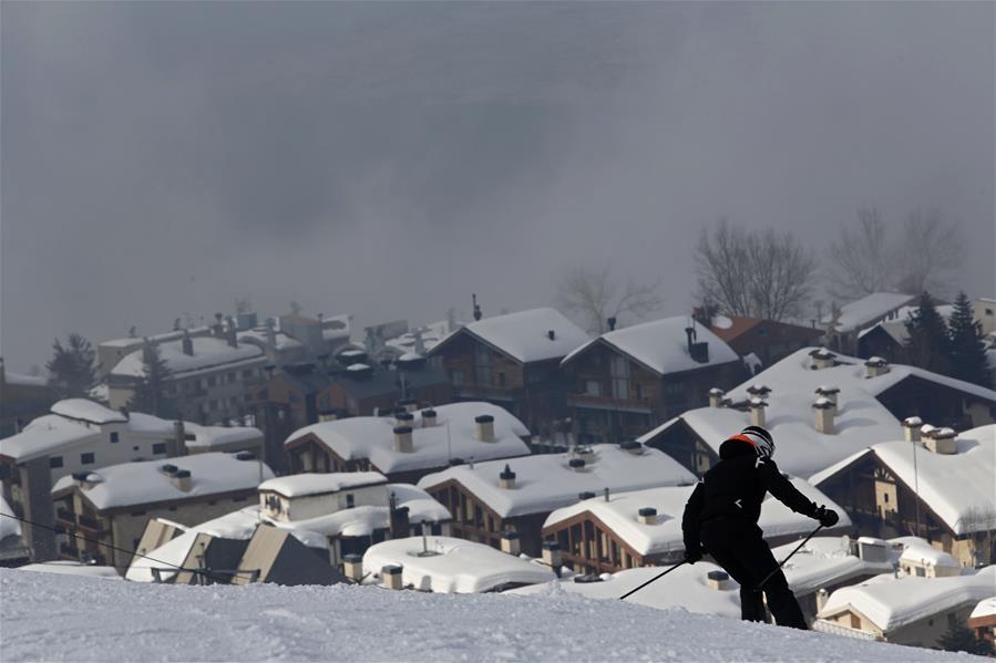 People enjoy skiing in ski resort in Mzaar Kfardebian, Lebanon