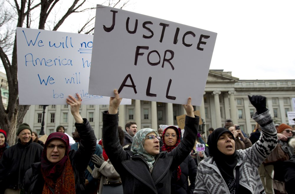 Court hears request to proceed with Trump travel ban cases