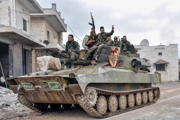 Syria army says retakes key northwest town
