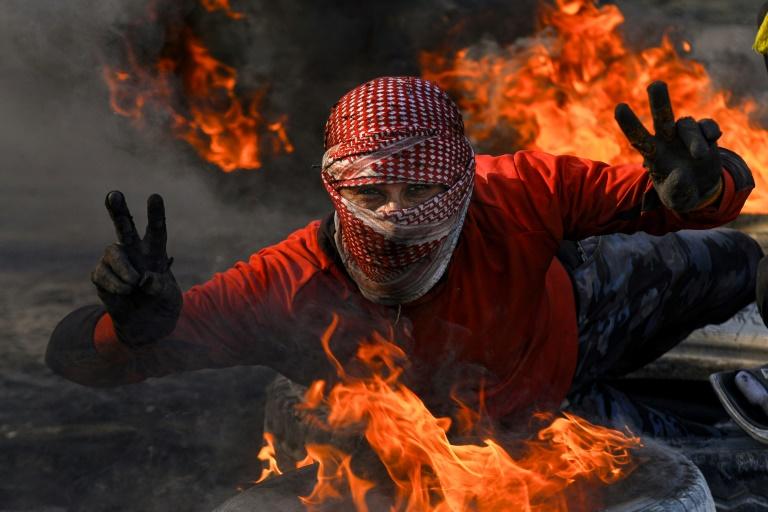 Iraqi protesters dig in heels despite new PM-designate