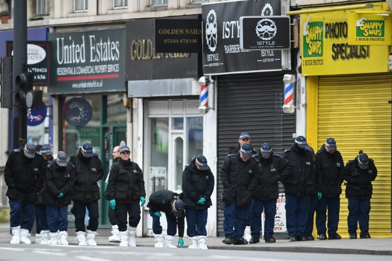 UK police search homes in terror stabbing probe