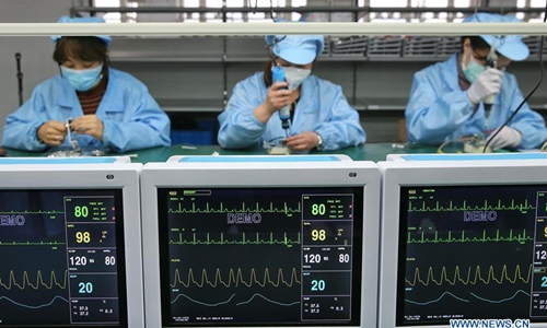 Daily production of diagnostic kits restored to 70 pct of normal levels: official