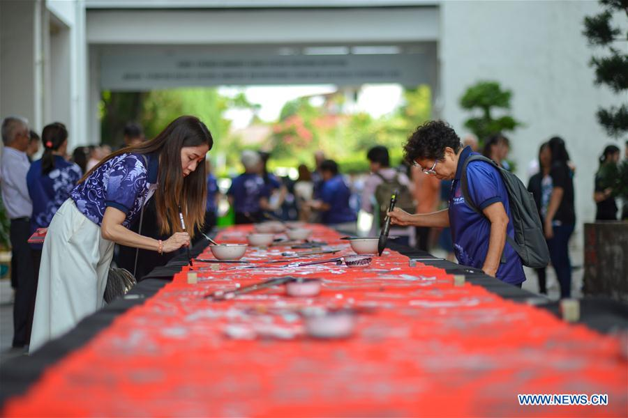 People participate in calligraphy event to show solidarity with China's fight against novel coronavirus in Malaysia