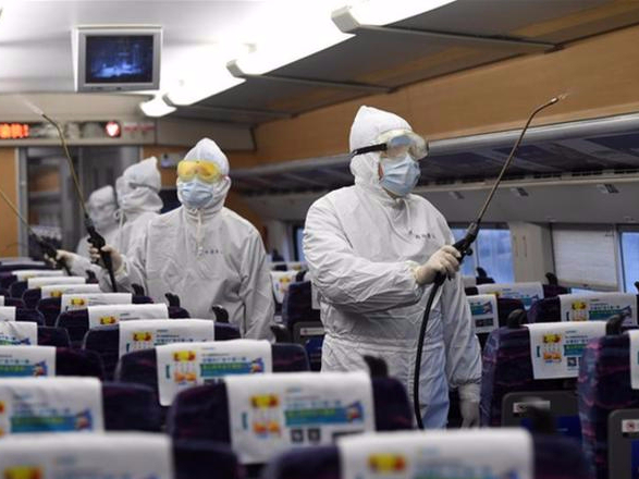 Train staff members conduct disinfection operations to prevent, control virus spread