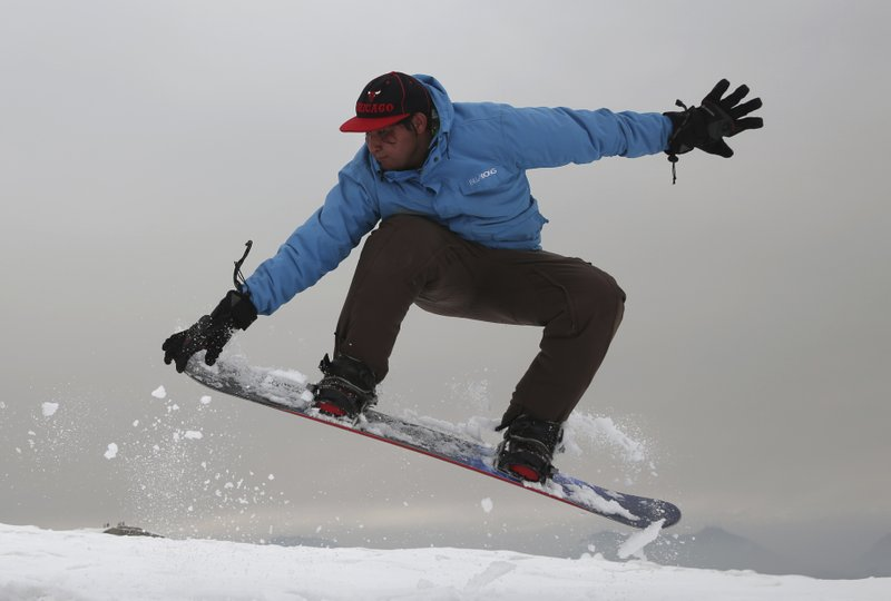 War-weary Afghan youth turn to snowboarding for thrills