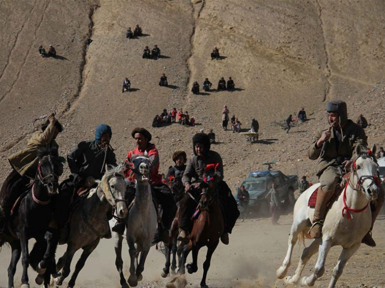 Afghan horse riders compete during Buzkashi match in Bamiyan province