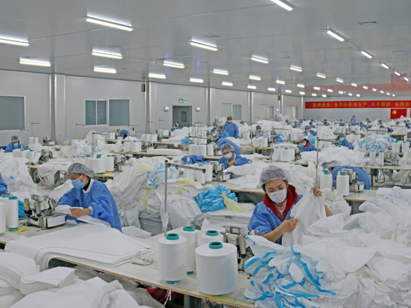 Fabric-making town goes all out to relieve protective medical suit shortage