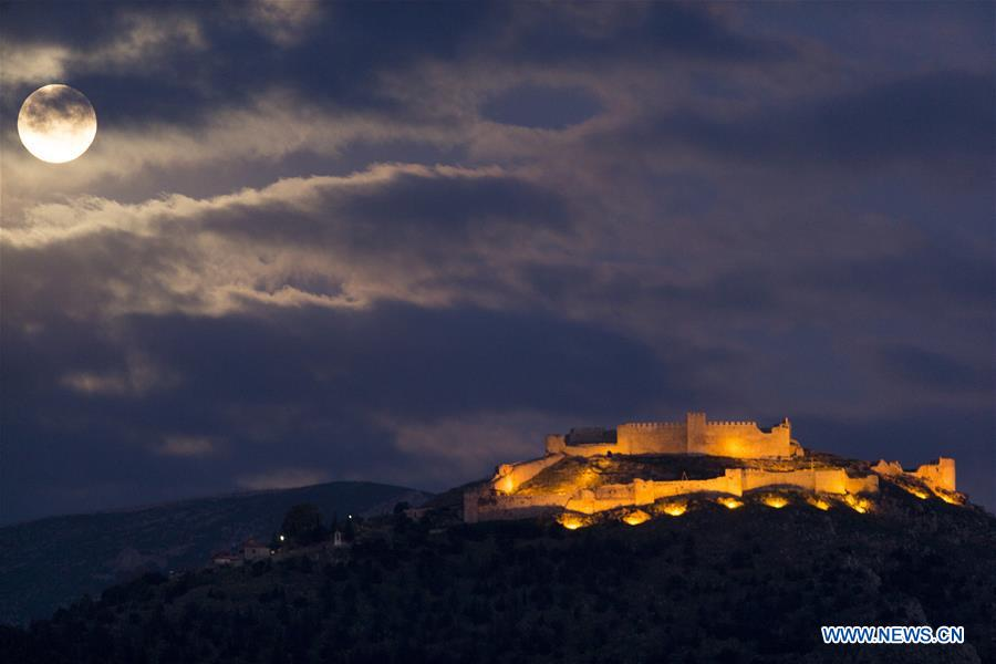 In pics: full moon seen above Larissa Castle in Argos, Greece