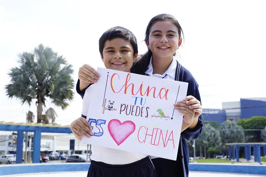 In pics: two children in El Salvador paint to encourage China to fight novel coronavirus pneumonia epidemic