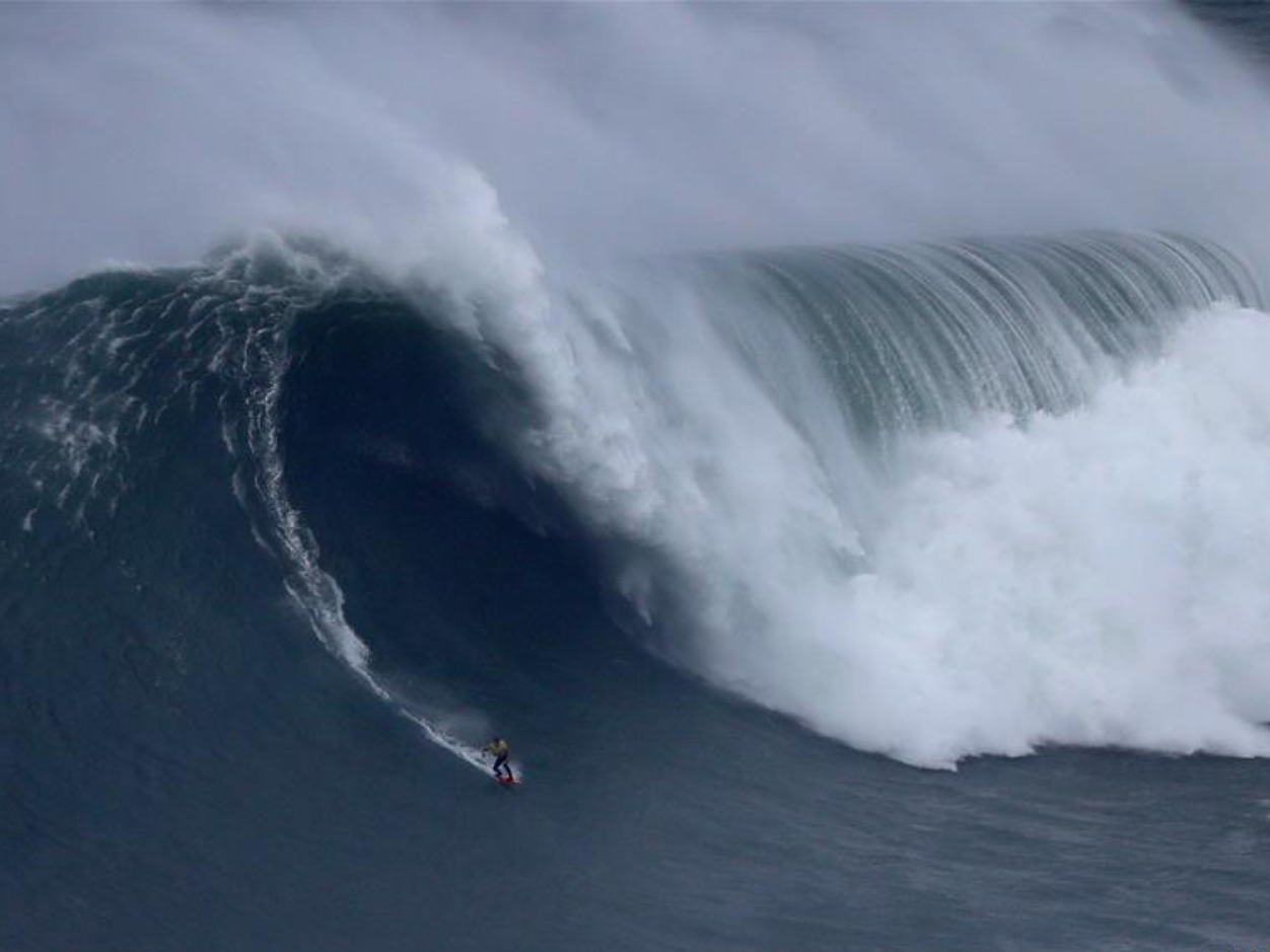 Highlights of Nazare Tow Surfing Challenge in Portugal