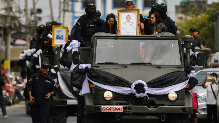 Thai king grants royal funerals to mass shooting victims