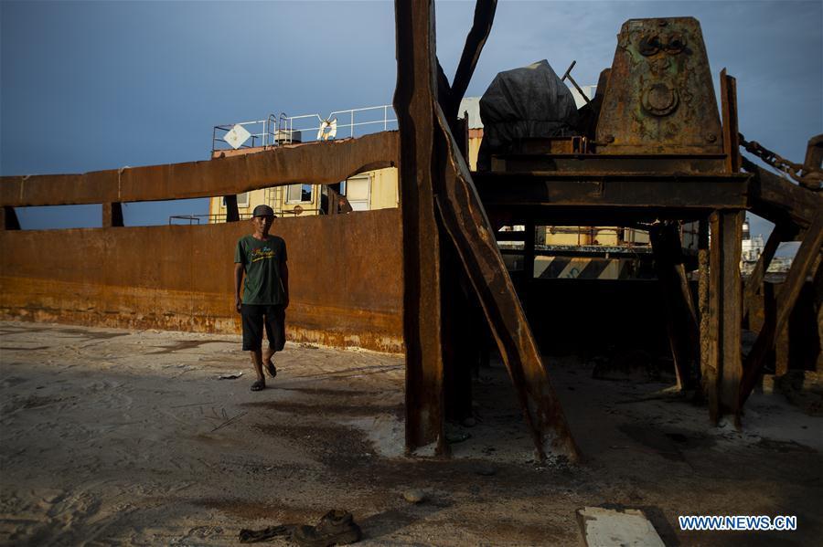 People work at ship breaking yard in Jakarta, Indonesia