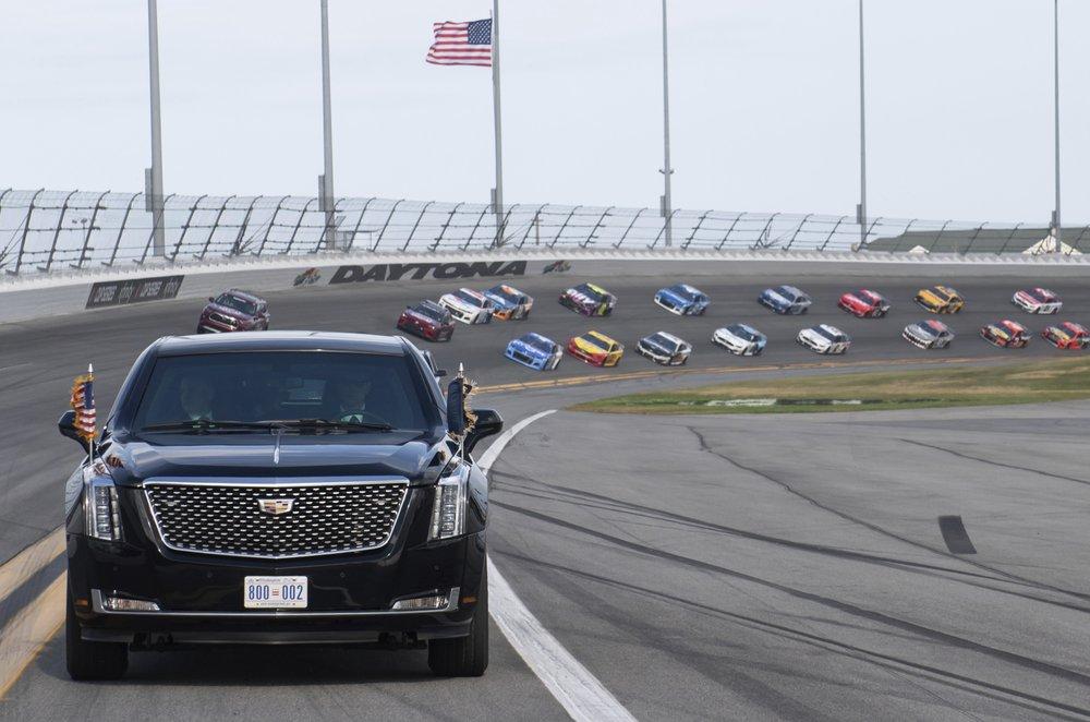 Daytona 500 resumes without president, pomp, packed house