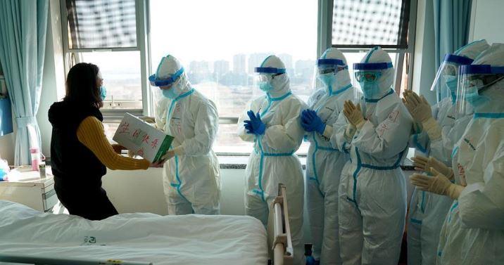 China's Hubei reports 1,693 new coronavirus cases