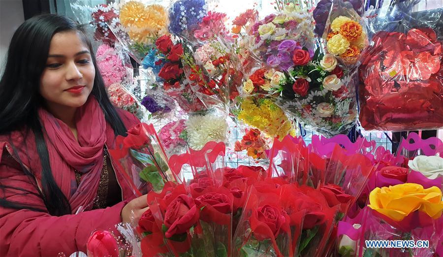 Vendor arranges flowers ahead of Valentine's day in Kathmandu, Nepal