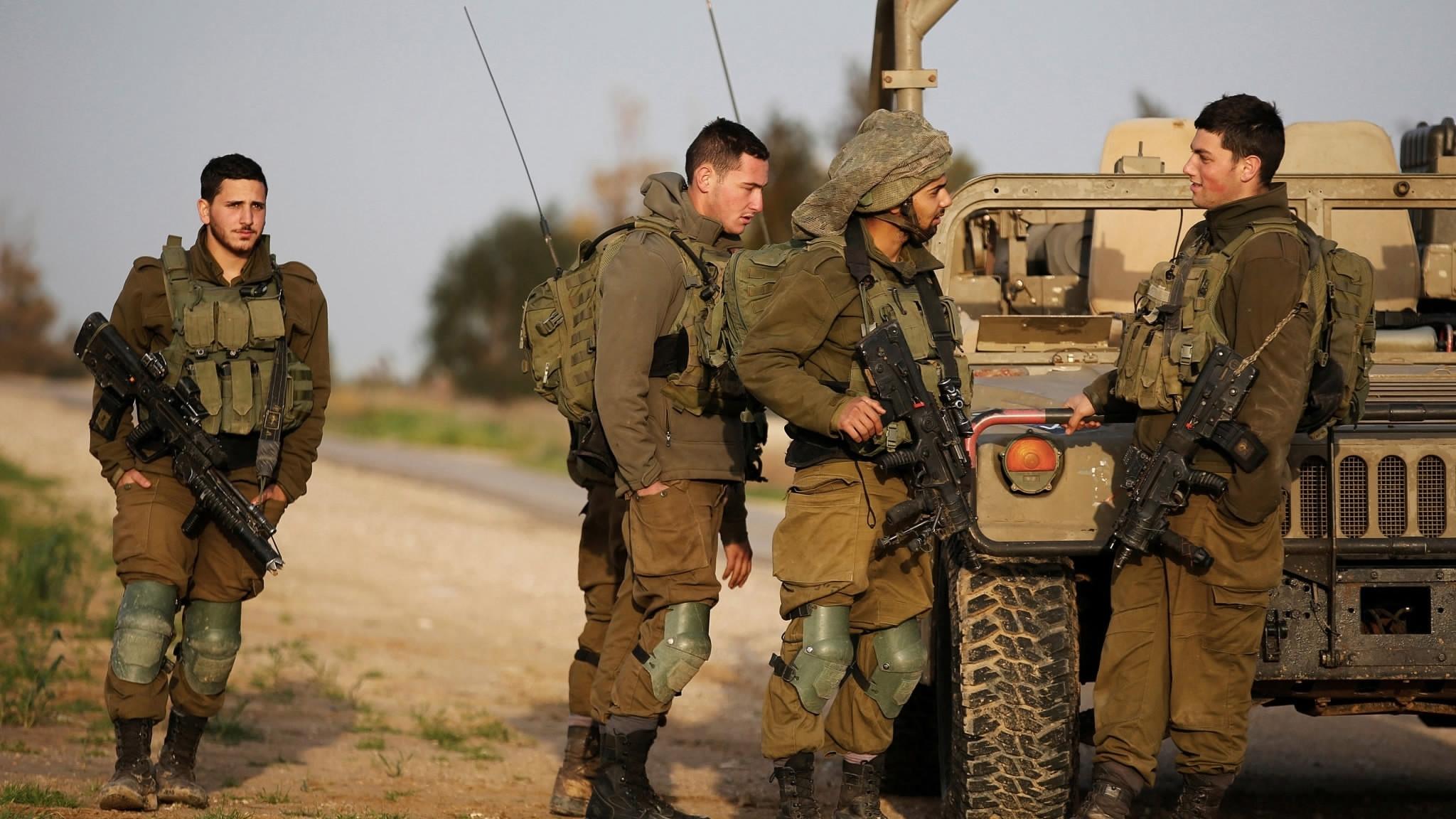 Israeli troops, Palestinian militants exchange fire near border