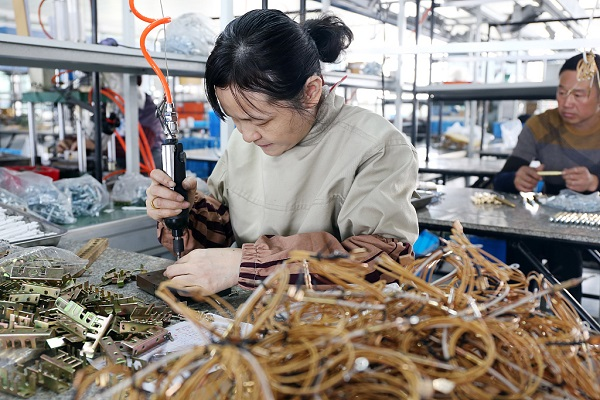 China to alleviate social security burden on employers