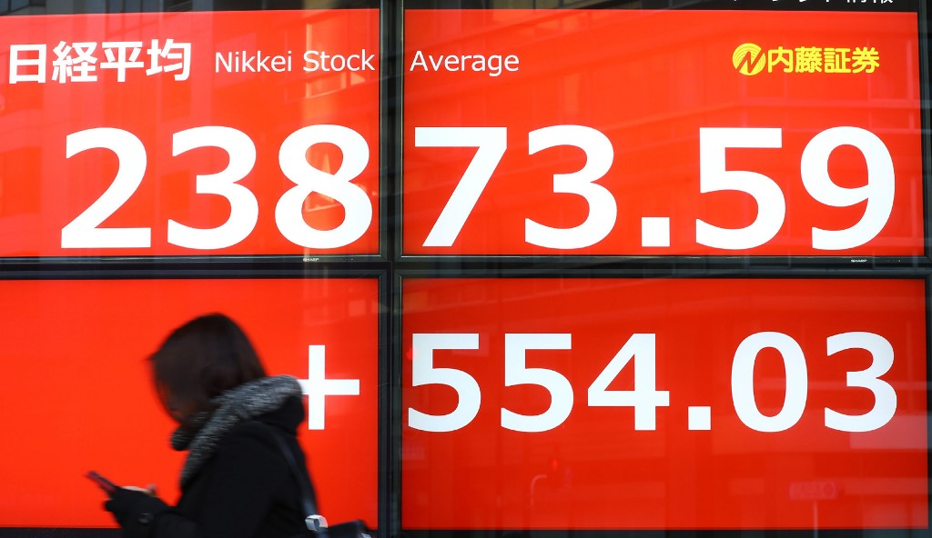 Tokyo stocks open sharply higher as yen's retreat gives exporters a boost