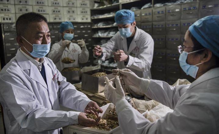 China's Hubei reports 411 new coronavirus cases