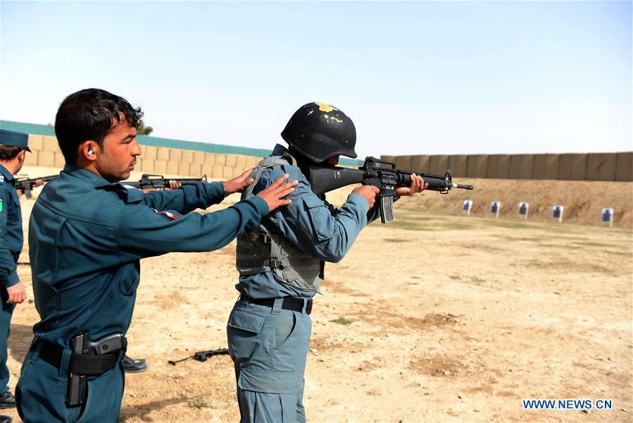 Afghan policemen take part in military training in Daman
