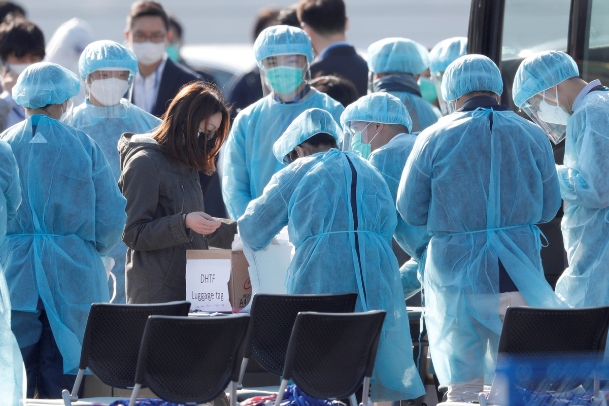 Japan reports two more virus-linked deaths, urges public events cancelled